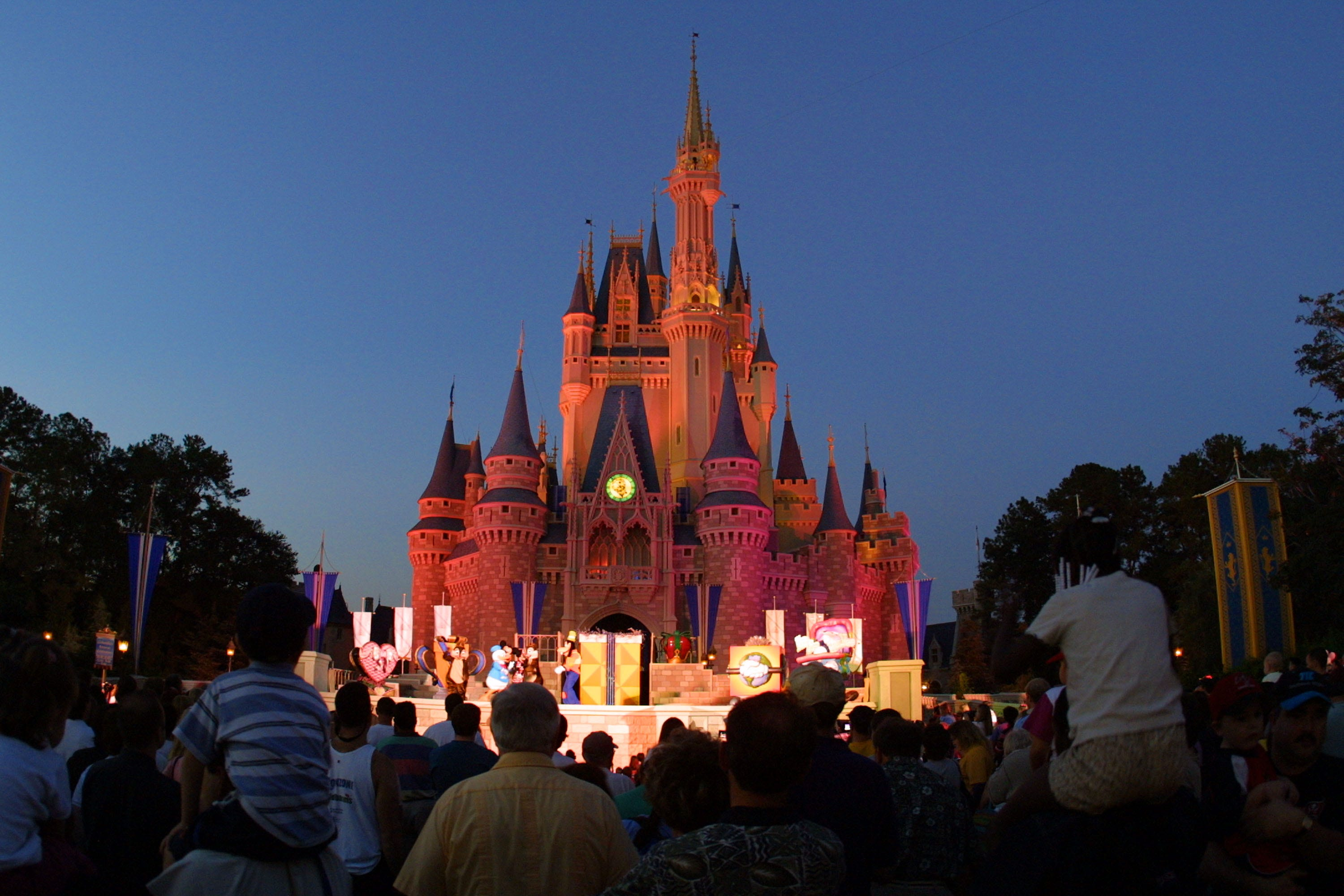 Slide 5 of 8: Cinderella Castle at Walt Disney World's Magic Kingdom lights up at night.