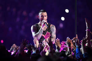 a man standing on a stage in front of a crowd: Levine and Maroon 5 rocked the halftime show in Super Bowl LIII at Mercedes-Benz Stadium in Atlanta on Feb. 2, 2019.