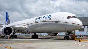 a large passenger jet sitting on top of a runway: The United Explorer card features solid benefits for occasional United flyers.