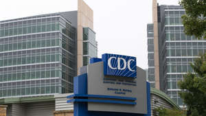 a sign in front of a building: CDC issues advisory about severe coronavirus-related illness in children