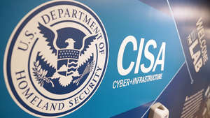 a close up of a sign: Senior DHS cybersecurity official to step down at end of week