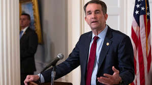 Ralph Northam wearing a suit and tie: Northam sending Virginia National Guard to DC in response to Capitol raid