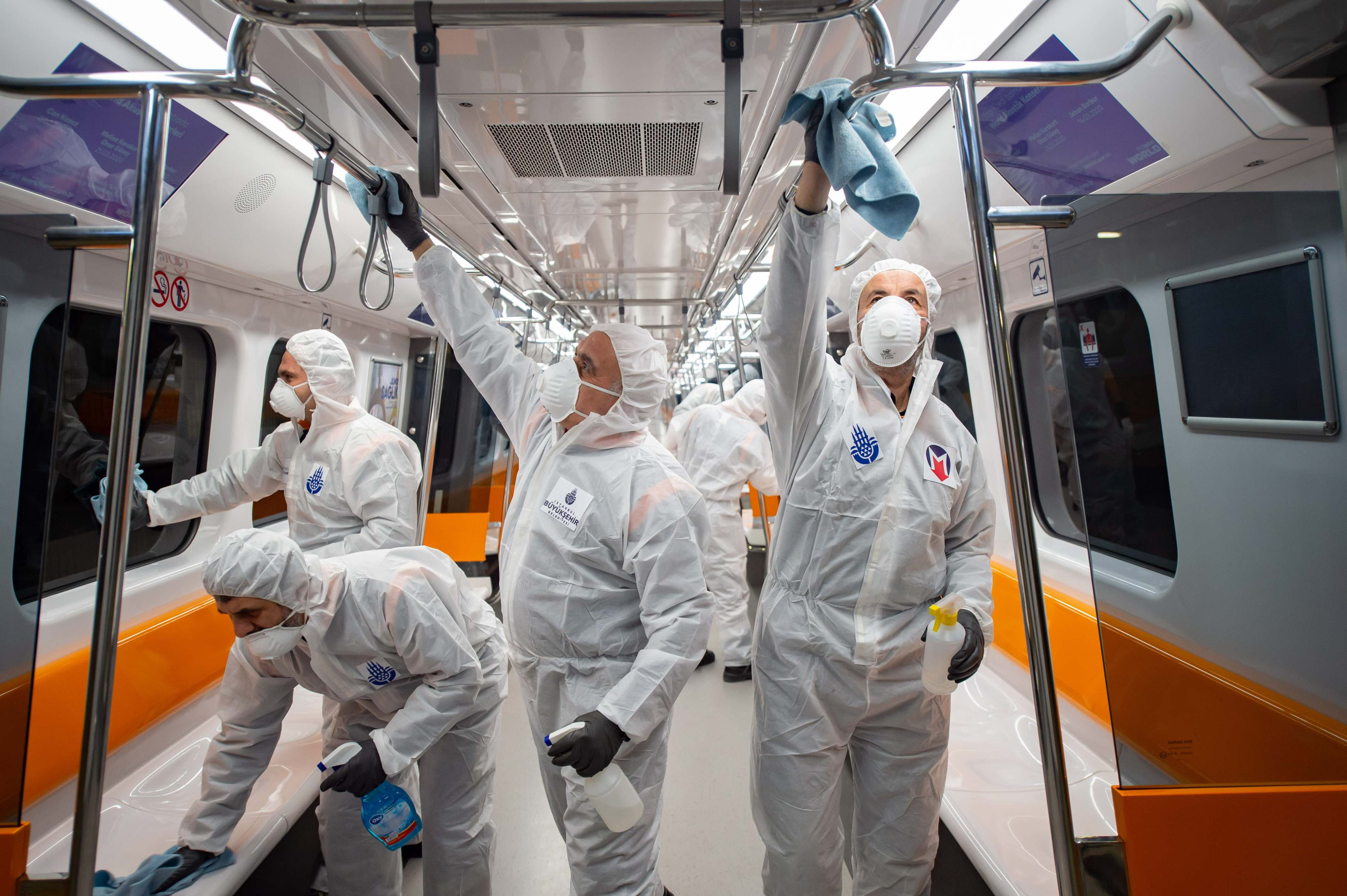 Slide 80 of 113: Employees of the Istanbul Municipality wearing protective gear disinfects a subway carriage to prevent the spread of the COVID-19, caused by the novel coronavirus, in Istanbul on March 12, 2020. Turkey announced on March 11, 2020 its first coronavirus case, a man who had recently travelled to Europe and is in good health.