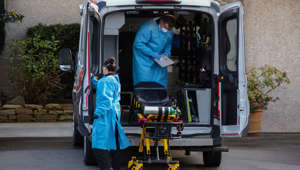 Medics clean their equipment after transporting a patient into Life Care Center of Kirkland, the long-term care facility linked to confirmed coronavirus cases in the state, during the coronavirus disease (COVID-19) outbreak, in Kirkland, Washington, U.S. March 24, 2020. REUTERS/David Ryder