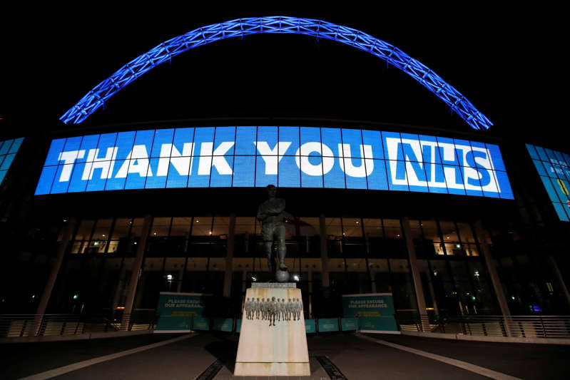 "A message reading ""Thank you NHS"" is displayed on the outside of Wembley Stadium"