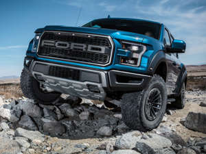 a blue car on a dirt road: The Ford Performance Division is responsible for the brand's supercars and racing cars like the Ford GT and GT MK II, as well as the storied Shelby Mustang lineup. In the mix in that elite shop and racing team is the F-150 Raptor, a powerful beast of a truck. Its 24-valve, 3.5-liter twin-turbo engine is good for a roaring 450 horsepower.    Related: Muscle Memories - 15 Ford Cars That Defined a Generation