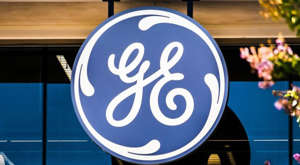 a blue and white sign: ge stock