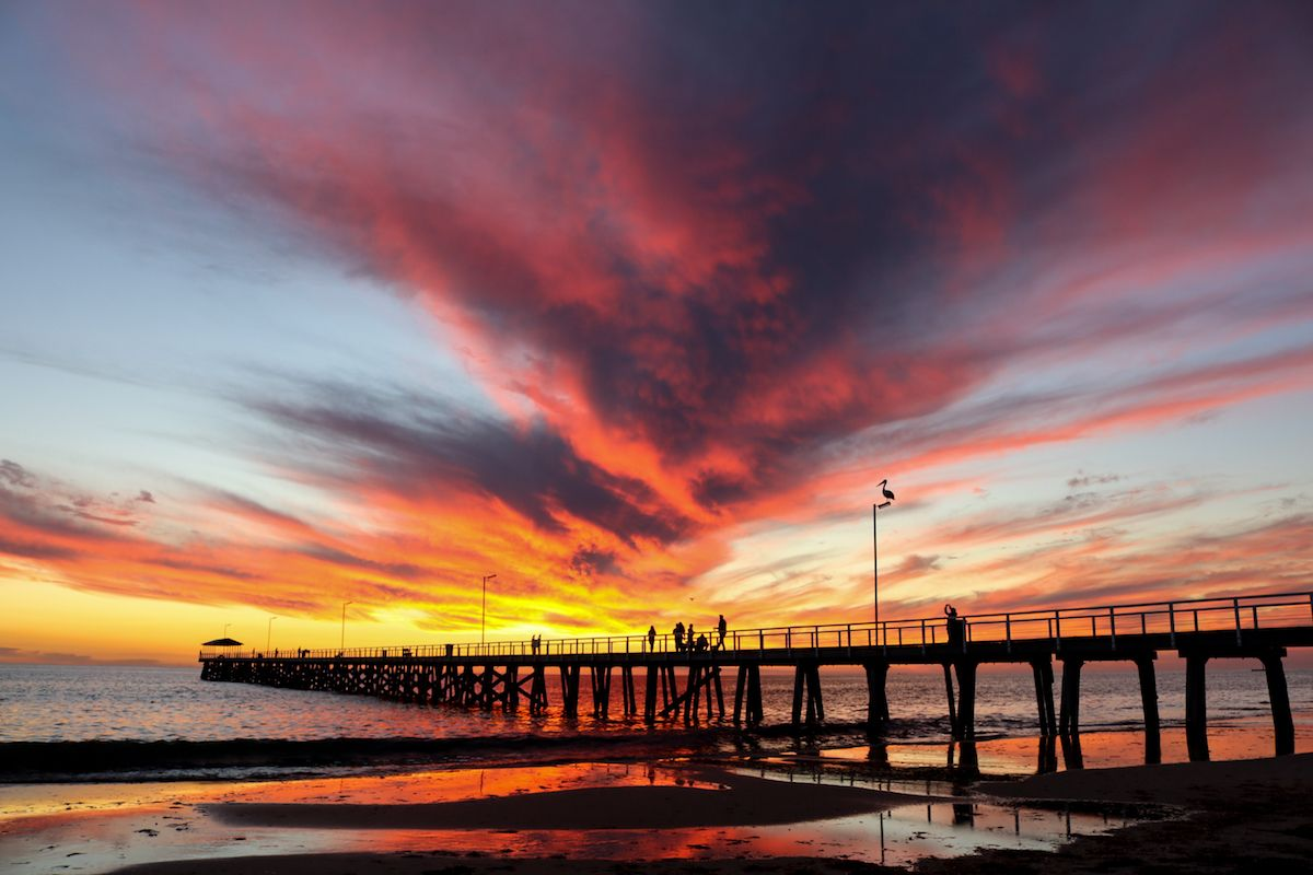 a sunset over a body of water: When you're stuck at a desk all day, it's easy to forget how breathtaking the world really is. Let these photos remind you of the stunning beauty that happens outside of your cubicle.