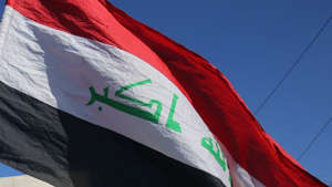 a close up of a flag: Service member with anti-ISIS coalition in Iraq dies in noncombat incident