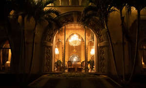 A window is illuminated at Mar-a-Lago during a dinner with President Donald Trump and Brazilian President Jair Bolsonaro, Saturday, March 7, 2020, in Palm Beach, Fla. (AP Photo/Alex Brandon)