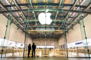Santa Monica, United States - 21 March, 2015: two unidentified persons watching inside the Apple store on 3rd Street Promenade in Santa Monica near Los Angeles in California. The retail chain owned and operated by Apple Inc is dealing with computers and electronics worldwide, with 453 retail stores in 16 countries.