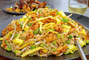 a dish is filled with food: Spicy-Shrimp-Fried-Rice