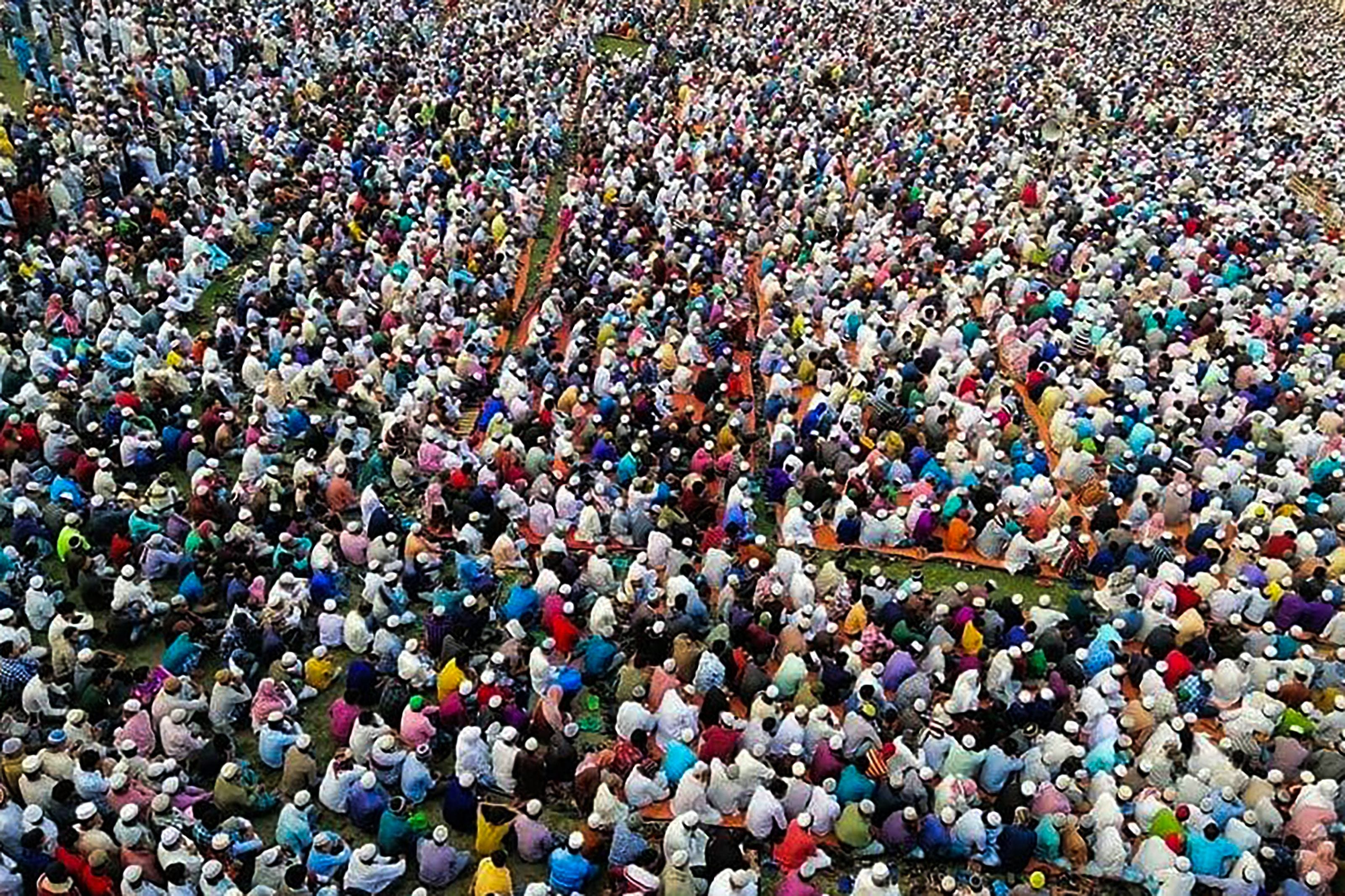 Slide 47 of 113: Thousands of Muslims attend a prayer session asking for safety amid concerns over the spread of the COVID-19 novel coronavirus, near Raipur in Lakshmipur district on March 18, 2020.Thousands of Muslims have joined a special prayer in a southern Bangladesh town seeking protection from the coronavirus to almighty, officials said on March 18 as the south Asian nation confirmed its first casualty by Covid-19.