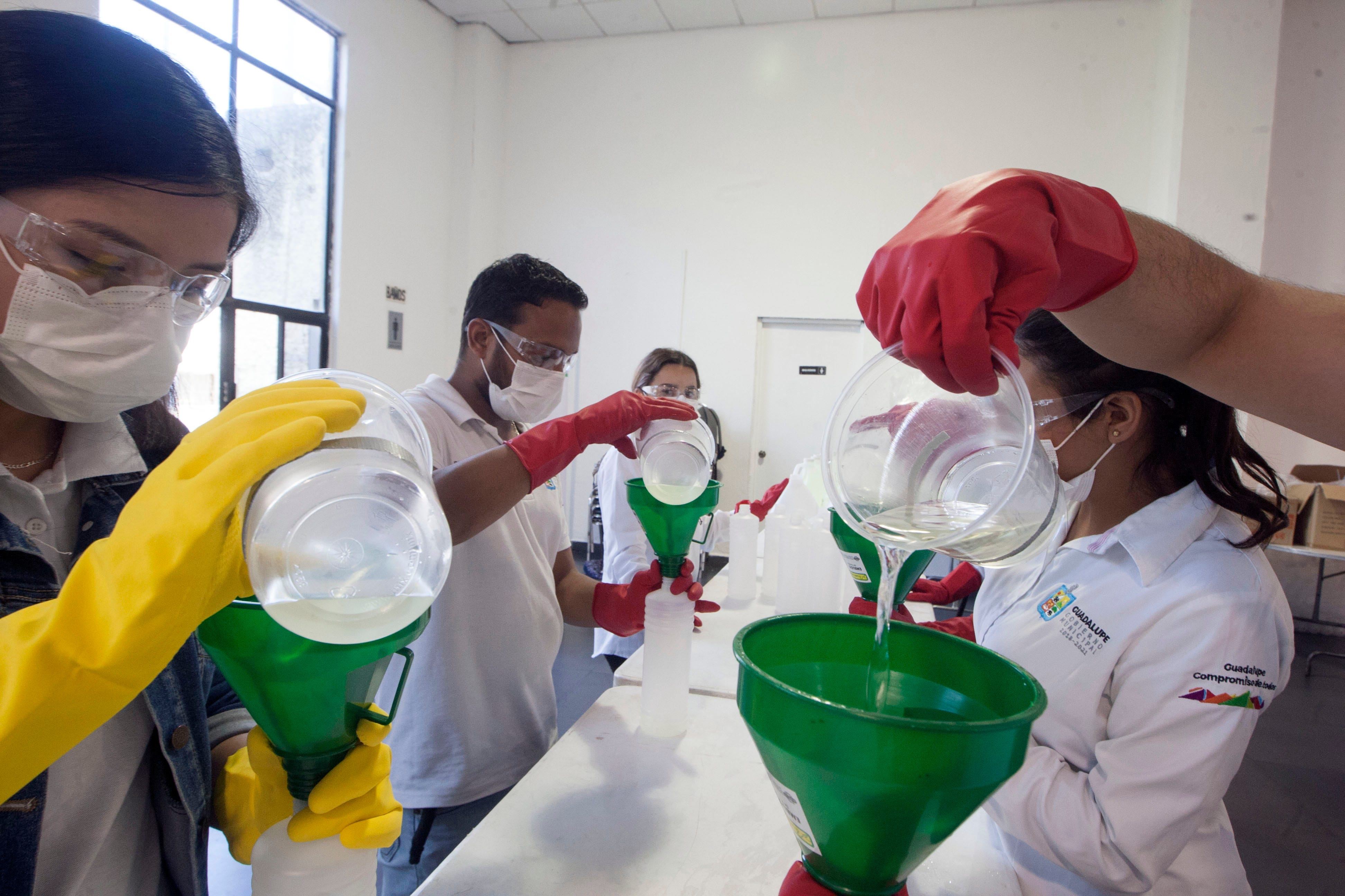 Slide 49 of 113: Volunteers pack hand sanitizer and disinfectant that will be distributed for free in Guadalupe, Nuevo Leon, Mexico on March 18 2020, as a preventive measure against the spread of the new coronavirus, COVID-19.