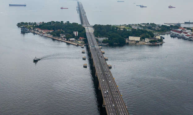 Slide 1 of 22: NITEROI, BRAZIL - MARCH 21:  An aerial view of a near empty Rio-Niteroi bridge that connects the cities of Niterói and Rio de Janeiro during Rio de Janeiros lock down aimed at stopping the spread of the coronavirus (COVID-19) pandemic on March 21, 2020 in Niteroi, Brazil. Rio de Janeiro's state government imposed restrictions to public transport. Bus lines and trains are closed, ferries and subway are running at a limited capacity. According to the Ministry of Health, as Friday, March 20, Brazil had 978 confirmed cases of coronavirus (COVID-19) and at least 11 recorded fatalities. (Photo by Buda Mendes/Getty Images)