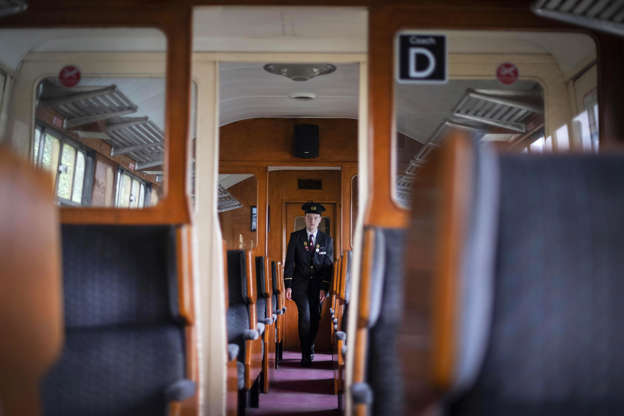 Slide 2 of 66: A ticket inspector walks through an empty train carriage as the Dartmouth Steam Railway suspends its services to the public due to the coronavirus outbreak. Picture date: Sunday March 22, 2020. See PA story HEALTH Coronavirus. Photo credit should read: Victoria Jones/PA Wire (Photo by Victoria Jones/PA Images via Getty Images)