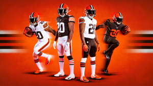 a group of baseball players standing on top of a field: browns-uniforms-2020-FTR