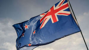 a flag flying on a cloudy day: New Zealand bank responding to data breach