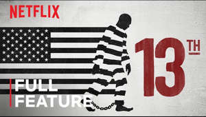 a close up of a logo: Combining archival footage with testimony from activists and scholars, director Ava DuVernay's examination of the U.S. prison system looks at how the country's history of racial inequality drives the high rate of incarceration in America.  This piercing, Oscar-nominated film won Best Documentary at the Emmys, the BAFTAs and the NAACP Image Awards.  US Rating: TV-MA For mature audiences. May not be suitable for ages 17 and under.   For more information and educational resources, please visit: https://media.netflix.com/en/company-blog/free-educational-documentaries  SUBSCRIBE: http://bit.ly/29qBUt7  About Netflix: Netflix is the world's leading streaming entertainment service with over 167 million paid memberships in over 190 countries enjoying TV series, documentaries and feature films across a wide variety of genres and languages. Members can watch as much as they want, anytime, anywhere, on any internet-connected screen. Members can play, pause and resume watching, all without commercials or commitments.  13TH | FULL FEATURE | Netflix https://youtube.com/Netflix