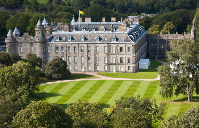 Slide 18 of 53: The Queen's official Scottish residence, the Palace of Holyroodhouse, sits at the end of the Royal Mile in Edinburgh. The palace has been the home of Scottish kings and queens since the 16th century, and past residents have included Mary, Queen of Scots.