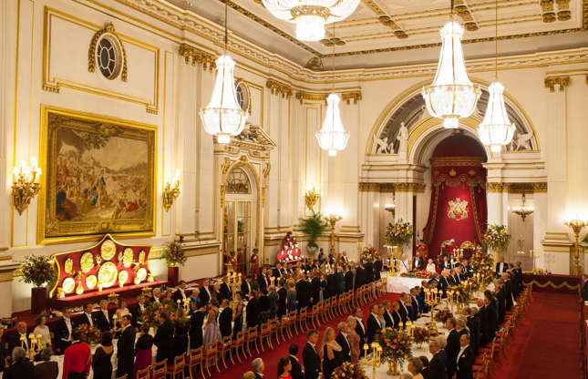 Slide 5 of 53: The Queen is usually ensconced in the palace during weekdays, when she conducts official business, from investitures, State banquets (pictured) and garden parties, to meeting and greeting dignitaries – the palace normally welcomes more than 50,000 VIP guests a year and opens to the public during the summer. This year will be quite different as lockdown and social distancing rules are applied.