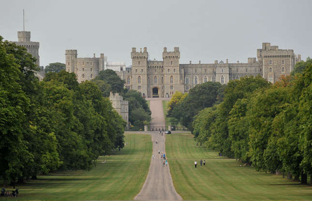 Slide 9 of 53: In contrast to her disdain for Buckingham Palace, Windsor Castle is thought to be the Queen's favorite official home. The 1,000-room castle, which is located in Windsor Great Park, just west of London, dates from the 11th century and sprawls over 484,000 square feet.