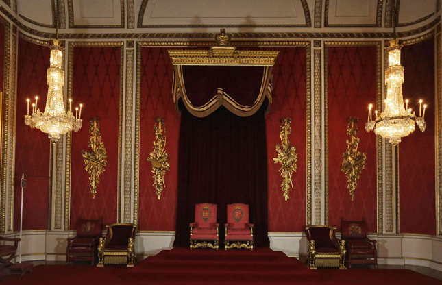 Slide 7 of 53: Other highlights include the Throne Room (pictured), Music Room and Picture Gallery, which includes works by Rembrandt and Vermeer. The palace also boasts 40 acres of grounds, a swimming pool, the Royal Mews stables and the Queen's Gallery, which exhibits 450 paintings at any one time.