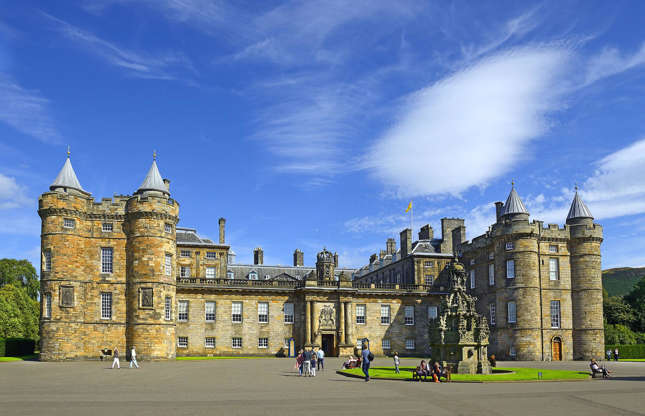 Slide 19 of 53: Holyroodhouse dates way back to 1128 when it was founded as a monastery. It was converted into a palace by Scottish King James IV in the early 16th century and further additions were made by James V of Scotland and later kings and queens of the United Kingdom.