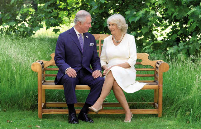 Slide 32 of 53: Prince Charles spends a lot of his time at Clarence House in the grounds, which are adorned with magnolia trees, a vegetable garden and a composting system. The royal enjoys hosting outdoor meetings, events and parties in the gardens and even used them as the background to his 2018 Christmas card (pictured).