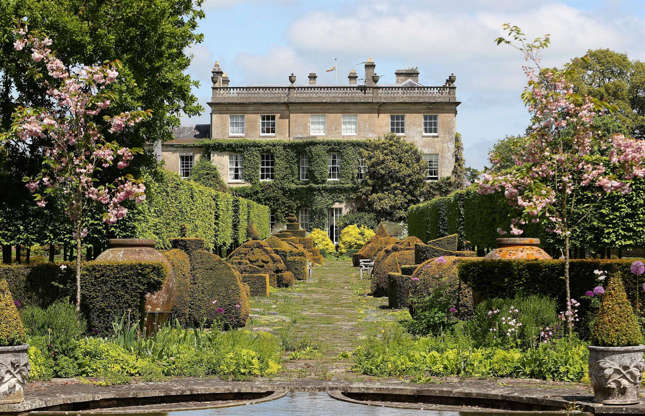 Slide 34 of 53: When the Prince of Wales first arrived at Highgrove House, the garden was sparse apart from an old cedar tree. Over a period of 38 years, Prince Charles has transformed it into an organic, tranquil oasis.