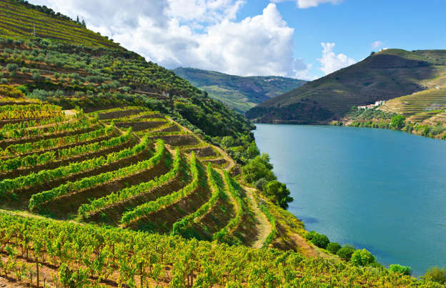 Slide 20 of 30: Sometimes natural and man-made beauty conspire to create something truly wonderful. The vineyards of Portugal's Douro Valley are a prime example. Etched into the hillsides, they perfectly demonstrate that practical can be very pretty indeed. The terraces are carved into the steep banks of the River Douro, taming the land to grow the grapes that produce the region's renowned port and red wines.