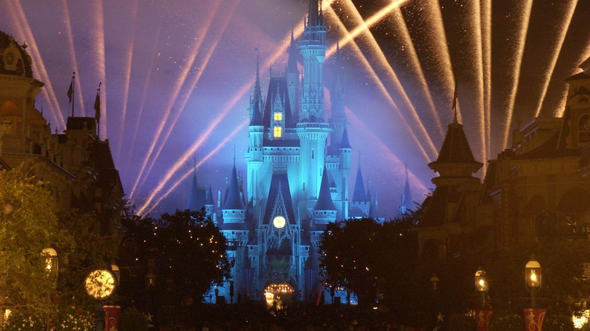 Slide 3 of 8: Lights illuminate Cinderella Castle.