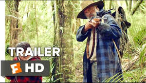 a person standing next to a forest: Subscribe to INDIE & FILM FESTIVALS: http://bit.ly/1wbkfYg Subscribe to TRAILERS: http://bit.ly/sxaw6h Subscribe to COMING SOON: http://bit.ly/H2vZUn Like us on FACEBOOK: http://goo.gl/dHs73 Follow us on TWITTER: http://bit.ly/1ghOWmt Hunt for the Wilderpeople Official Trailer 1 (2016) - Sam Neill, Rhys Darby Movie HD  A national manhunt is ordered for a rebellious kid and his foster uncle who go missing in the wild New Zealand bush.  You're quite the artsy one, aren't you? Fandango MOVIECLIPS FILM FESTIVALS & INDIE TRAILERS is the destination for...well, all things related to Film Festivals & Indie Films. If you want to keep up with the latest festival news, art house openings, indie movie content, film reviews, and so much more, then you have found the right channel.