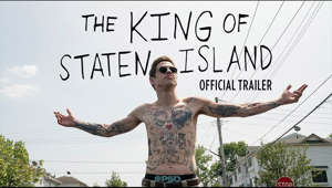 a man holding a sign: Trailer's here. Pete Davidson is #TheKingOfStatenIsland. Available on demand June 12.  -- Facebook:  https://uni.pictures/StatenIslandFB Twitter:      https://uni.pictures/StatenIslandTW Instagram:  https://uni.pictures/StatenIslandIG Site: http://uni.pictures/StatenIsland -- Over his storied career, Judd Apatow has elevated a series of promising young comedy talents to their first major big-screen performance, including Steve Carell, Seth Rogen, Jonah Hill, Jason Segel, Kristen Wiig, Amy Schumer and Kumail Nanjiani.    This summer, Apatow directs Saturday Night Live breakout Pete Davidson in a bracing comedy about love, loss and laughter on Staten Island.   Scott (Davidson) has been a case of arrested development ever since his firefighter father died when he was seven. He's now reached his mid-20s having achieved little, chasing a dream of becoming a tattoo artist that seems far out of reach. As his ambitious younger sister (Maude Apatow, HBO's Euphoria) heads off to college, Scott is still living with his exhausted ER nurse mother (Oscar® winner Marisa Tomei) and spends his days smoking weed, hanging with the guys—Oscar (Ricky Velez, Master of None), Igor (Moises Arias, Five Feet Apart) and Richie (Lou Wilson, TV's The Guest Book)—and secretly hooking up with his childhood friend Kelsey (Bel Powley, Apple TV+'s The Morning Show).   But when his mother starts dating a loudmouth firefighter named Ray (Bill Burr, Netflix's F Is for Family), it sets off a chain of events that will force Scott to grapple with his grief and take his first tentative steps toward moving forward in life.   The film also stars Steve Buscemi as Papa, a veteran firefighter who takes Scott under his wing, and Pamela Adlon (FX's Better Things) as Ray's ex-wife, Gina.    The King of Staten Island is directed by Apatow (Trainwreck, Knocked Up, The 40-Year-Old Virgin) from a script by Apatow, Davidson and former SNL writer Dave Sirus. It is produced by Apatow for his Apatow Productions alongside Barry Mendel. Together, the duo shared producing credits on the Academy Award®-nominated films The Big Sick and Bridesmaids, as well as This Is 40, Trainwreck and Funny People. The film's executive producers are Pete Davidson, Michael Bederman and Judah Miller.