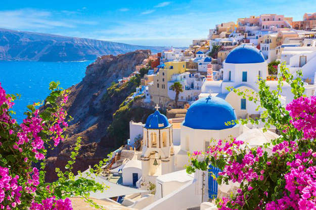 "Technically a group of islands rather than just one, Santorini is known as a wedding, beach and culinary destination. It's also an active volcano, whose crater lies in the Aegean Sea. Julie Leta of Cincinnati, Ohio, can't wait to get back to Greece, specifically to Santorini, for four or five nights after revisiting Italy. Battling surgeries and illness for the past year, she says she wants to take this trip ""sooner than later. The last year has taught me we have less time than we think."""