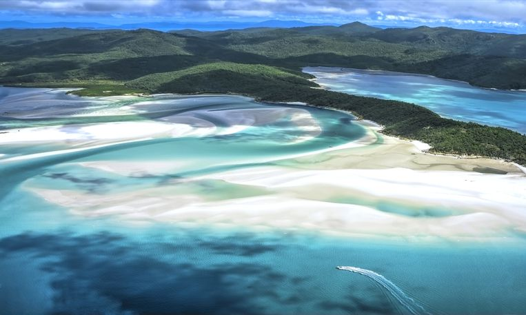 Slide 25 of 26: Located off coastal Queensland, The Whitsunday Islands are home to Great Barrier Reef, one of the seven wonders of the world and the largest living structure (it's visible from outer space!). While the Whitsundays comprise 74 separate islands, most of them are uninhabited, but four are incredible travel destinations: Hamilton Island, Hayman Island, Long Island and Daydream Island. These are famous for the fine white sand of their beaches, the acrobatics of humpback whales, the ancient rock art of Australia's earliest indigenous peoples, and all the water sports you can think of (snorkeling, sailing, rafting, kayaking and more).