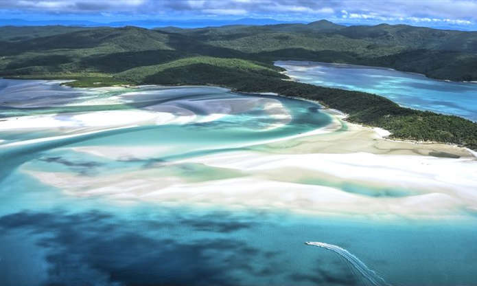 Located off coastal Queensland, The Whitsunday Islands are home to Great Barrier Reef, one of the seven wonders of the world and the largest living structure (it's visible from outer space!). While the Whitsundays comprise 74 separate islands, most of them are uninhabited, but four are incredible travel destinations: Hamilton Island, Hayman Island, Long Island and Daydream Island. These are famous for the fine white sand of their beaches, the acrobatics of humpback whales, the ancient rock art of Australia's earliest indigenous peoples, and all the water sports you can think of (snorkeling, sailing, rafting, kayaking and more).