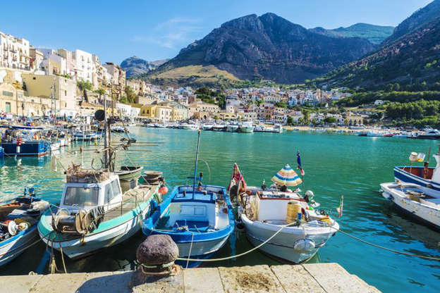 "Located just off the toe of the ""boot"" of Italy, Sicily is the largest of the Mediterranean islands. Some of the best-preserved Greek ruins are located there, such as The Valley of the Temples, as well as resort towns and beautiful beaches. And of course, there's the food: From arancini and  pasta alla Norma (named after the 19th century opera) to cannoli and granita, you could plan your whole trip around what dishes to eat and what wine to drink."