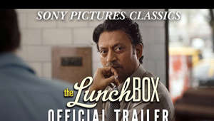 Irrfan Khan looking at the camera: Middle class housewife Ila is trying once again to add some spice to her marriage, this time through her cooking. She desperately hopes that this new recipe will finally arouse some kind of reaction from her neglectful husband. She prepares a special lunchbox to be delivered to him at work, but, unbeknownst to her, it is mistakenly delivered to another office worker, Saajan, a lonely man on the verge of retirement. Curious about the lack of reaction from her husband, Ila puts a little note in the following day's lunchbox, in the hopes of getting to the bottom of the mystery.  This begins a series of lunchbox notes between Saajan and Ila, and the mere comfort of communicating with a stranger anonymously soon evolves into an unexpected friendship. Gradually, their notes become little confessions about their loneliness, memories, regrets, fears, and even small joys. They each discover a new sense of self and find an anchor to hold on to in the big city of Mumbai that so often crushes hopes and dreams. Still strangers physically, Ila and Saajan become lost in a virtual relationship that could jeopardize both their realities.  http://sonyclassics.com/thelunchbox/