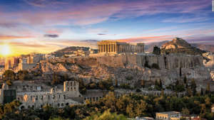 a castle like building in a city: Greece has ancient ruins like the Parthenon, plus some of Europe's loveliest islands.