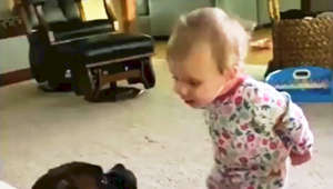 Too cute! This baby can't stop talking to her doggy best friend