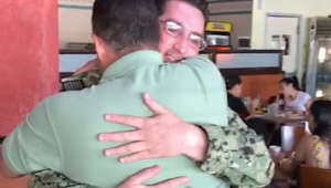 Sailor surprises dad after two years away