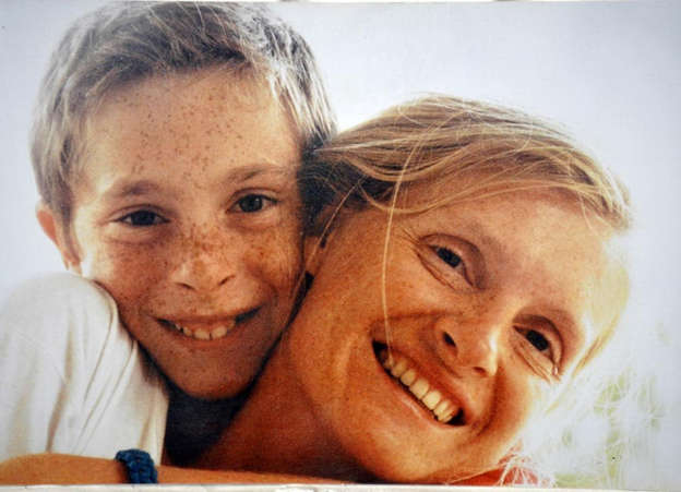 a man and a woman smiling for the camera: Pierre-Louis aged nine with mother Sophie Toscan du Plantier. Pic: File