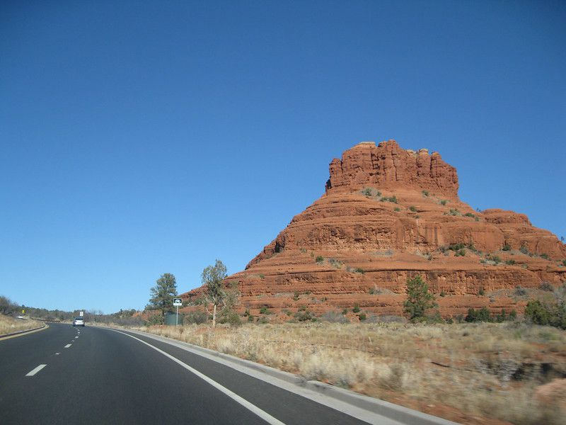 Slide 5 of 13: Route 66 is a road trip classic, and this section of Arizona highway is part of it. Passing by Sedona, Highway 179 has a ton of things to look at, and we don't just mean the beautiful scenery (though there is a lot of that).Known as the Red Rock Scenic Byway, this short 7.5-mile drive has a lot to see, and plenty of worthy stops to stretch your legs. You'll spy famous formations, such as Bell Rock and Cathedral Rock (both believed by some to be vortexes), and you'll even pass formations containing Native American cliff dwellings and petroglyph sites.If you're looking to get out in nature, opt for the 3.6-mile trail up to Bell Rock (also known as the Bell Rock Pathway) for a closer look, and maybe even some of those positive vortex vibes.