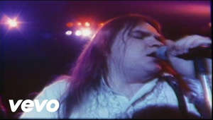 "a blurry close up of a man: Watch the official music video for ""You Took The Words Right Out Of My Mouth (Hot Summer Night)"" by Meat Loaf Listen to Meat Loaf: https://Meatloaf.lnk.to/listenYD  Subscribe to the official Meat Loaf YouTube channel: https://Meatloaf.lnk.to/subscribeYD  Watch more Meat Loaf videos: https://Meatloaf.lnk.to/listenYC/youtube  Follow Meat Loaf: Facebook: https://Meatloaf.lnk.to/followFI Twitter: https://Meatloaf.lnk.to/followTI Website: https://Meatloaf.lnk.to/followWI Spotify: https://Meatloaf.lnk.to/followSI YouTube: https://Meatloaf.lnk.to/subscribeYD  Lyrics:   It was a hot summer night and the beach was burning. There was fog crawling over the sand. When I listen to your heart I hear the whole world turning. I see the shooting stars falling through your trembling hands.   And then you took the words right out of my mouth. Oh it must have been while you were kissing me. You took the words right out of my mouth. And I swear it's true, I was just about to say I love you. And then you took the words right out of my mouth. Oh it must have been while you were kissing me. You took the words right out of my mouth. And I swear it's true, I was just about to say I love you.  #MeatLoaf #YouTookTheWordsRightOutOfMyMouth #OfficialMusicVideo"