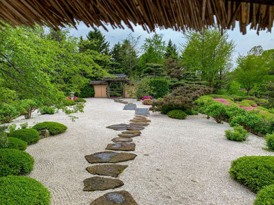 Slide 5 of 13: This tranquil outdoor space belongs in the historic Chicago Botanic Garden. A large stone path creates interest and keeps your smaller rocks looking pristine.