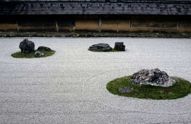 Slide 2 of 13: Ryōan-ji is Japan's most famous rock garden, residing in the capital city of Kyoto. This garden is enclosed by clay walls and serves as a meditation space for monks studying at Myoshin-ji school of Zen Buddhism.