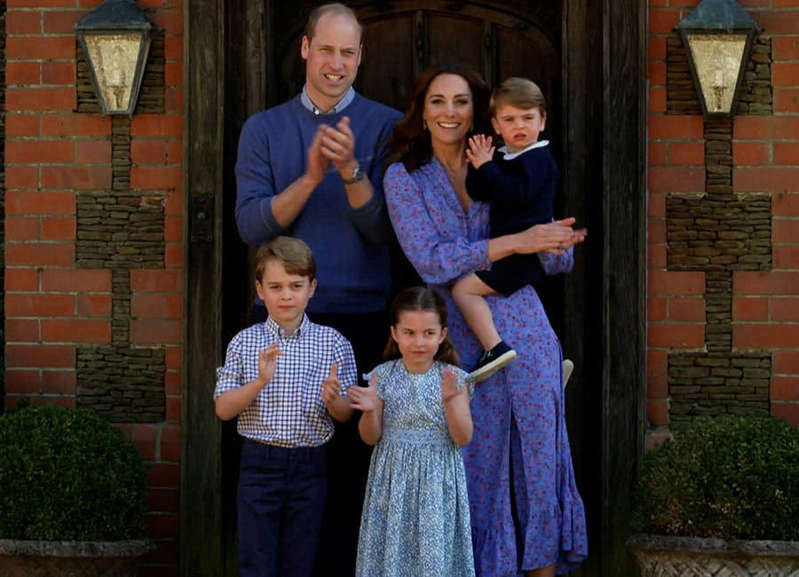 Prince William, Duke of Cambridge et al. standing in front of a brick building: Prince William and Kate Middleton with Prince George, Princess Charlotte and Prince Louis Pic: Getty
