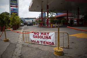 "A banner that reads in Spanish reads ""There is no Gasoline"" is displayed at a closed fuel station in Caracas, Venezuela, Sunday, May 24, 2020. The first of five tankers loaded with gasoline sent from Iran has reached Venezuelan waters with no immediate signs of U.S. interference. The ships' loads are expected to temporarily ease the South American nation's fuel crunch while defying Trump administration sanctions targeting the two U.S. foes. (AP Photo/Ariana Cubillos)"