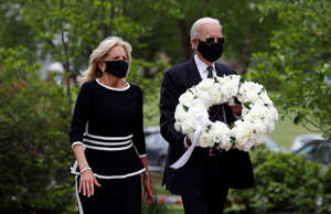 Democratic presidential candidate, former Vice President Joe Biden and Jill Biden arrive to place a wreath at the Delaware Memorial Bridge Veterans Memorial Park, Monday, May 25, 2020, in New Castle, Del. (AP Photo/Patrick Semansky)